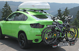 BMW X6 with roof box and bike carrier