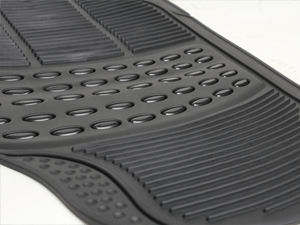 Detailed view of rubber floor mat including trim marks
