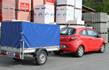 Opel Corsa D with cargo trailer